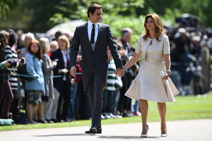 Swiss tennis player Roger Federer (L) and his wife Mirka attend the wedding of Pippa Middleton and James Matthews at St Mark's Church in Englefield, west of London, on May 20, 2017. Pippa Middleton hit the headlines with a figure-hugging outfit at her sister Kate's wedding to Prince William but now the world-famous bridesmaid is becoming a bride herself. Once again, all eyes will be on her dress as the 33-year-old marries financier James Matthews on Saturday at a lavish society wedding where William and Kate's children will play starring roles. / AFP PHOTO / POOL / Justin TALLIS (Photo credit should read JUSTIN TALLIS/AFP/Getty Images)